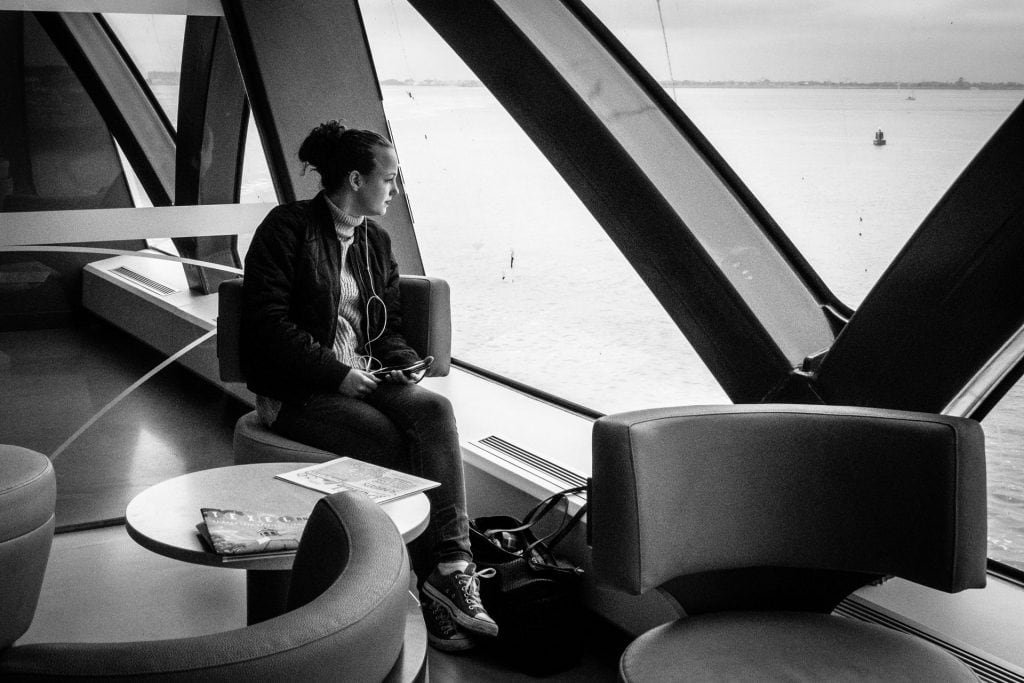 Smartphone girl on a ferry